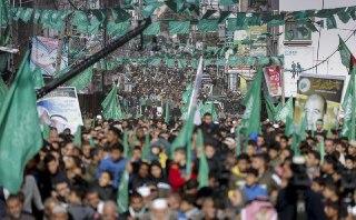 Memperingati 32 Tahun Harokah Al-Muqowwamah  Al-Islamiyah  -HAMAS .Intifadhah Batu , Rakyat Tetap Teguh Dan Spartan